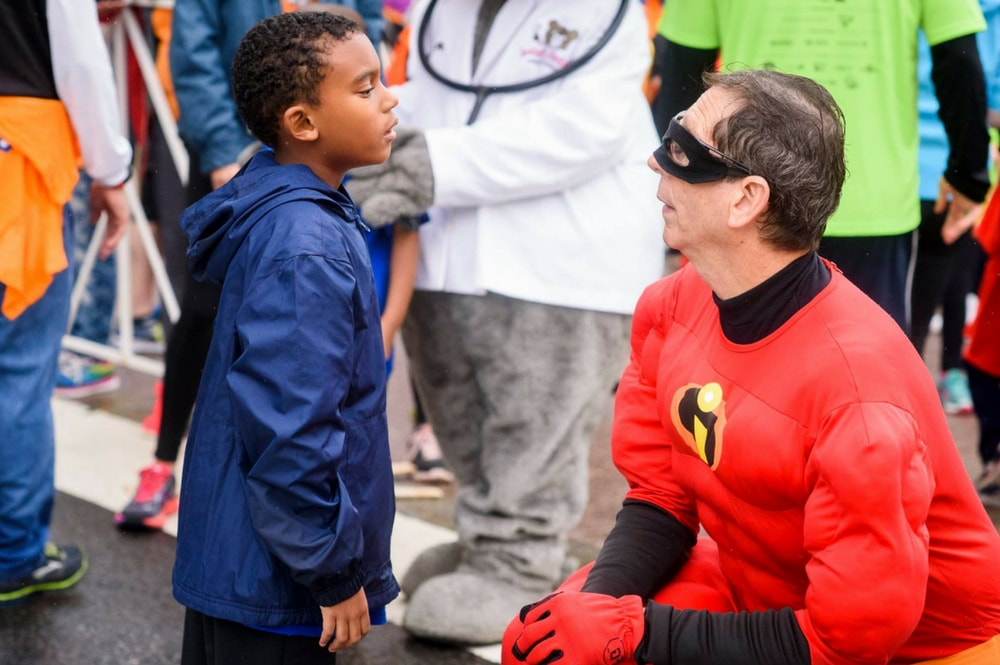 Dr. Silberman, dressed as Mr. Incredible at a charity event.